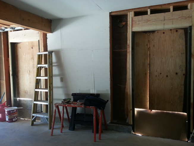 Two new door openings into new garage/workshop.