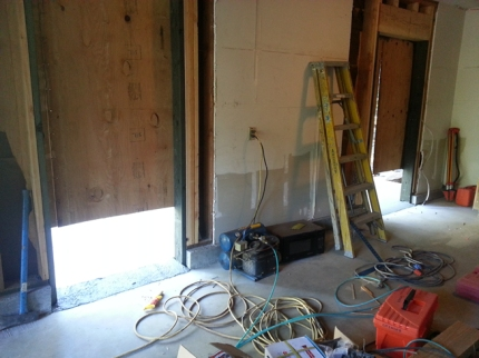 Sloped entries (2 openings for doors) into the old garage-no steps!