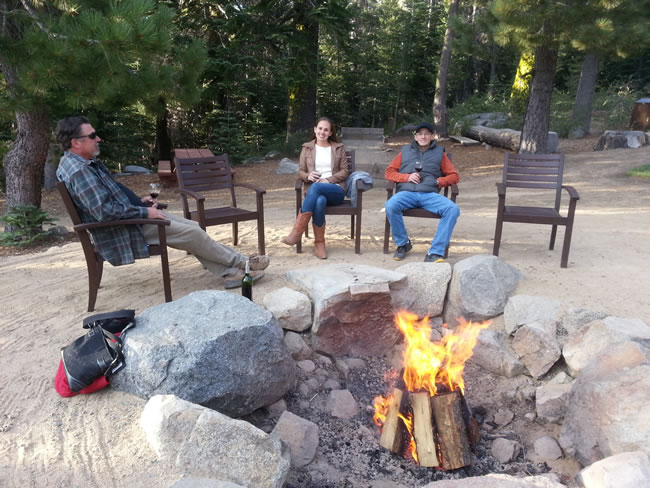 Beautiful fire pit area, Bob, Tricia & Jim relaxing before dinner.