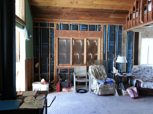 The perfect living room?  Not!  Notice the garage thru the window-this window will be gone.