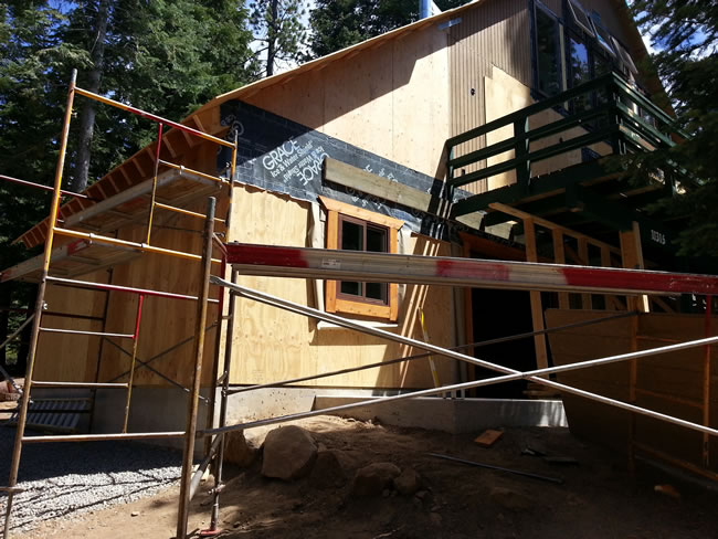 Garage built with window and new window exterior trim in place.