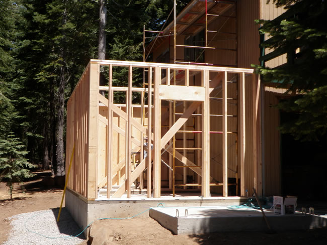 Walls framing in place and window framing begun.  If you look closely you can see the wall separating the workshop & storage area.
