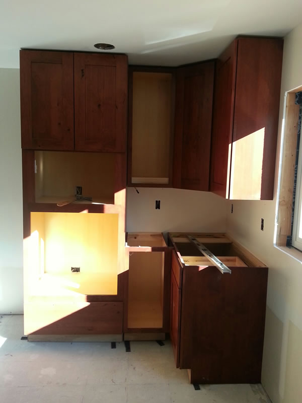 First cabinet installed was the upper corner.  Then the other upper cabinets, then the lower cabinets. Oct. 25th.