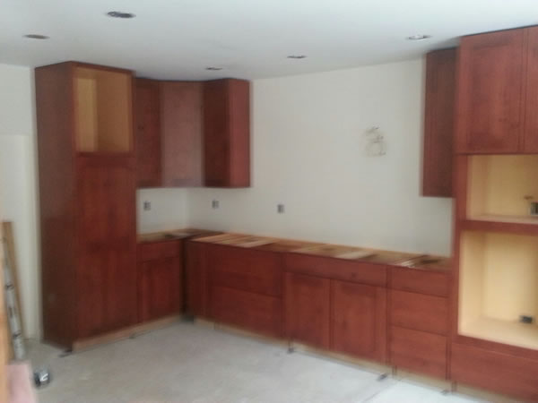 Oct. 28th installed the cabinets to along the back of the kitchen and turned the corner.