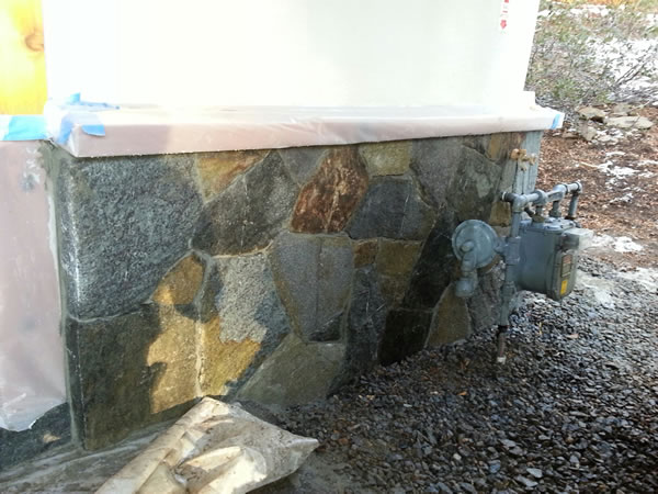 Finished granite behind the gas meter.