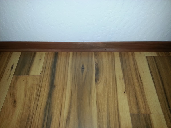"Quick Step Hickory Laminate flooring with Redwood 2"" baseboard and 1/4 round redwood trim"