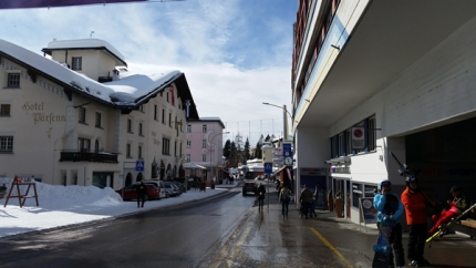 Parsenn Hotel with snow on the roof and entrance to the Parsenn Bahn across the stree.
