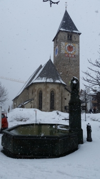 Beautiful church and fountain in Klosters